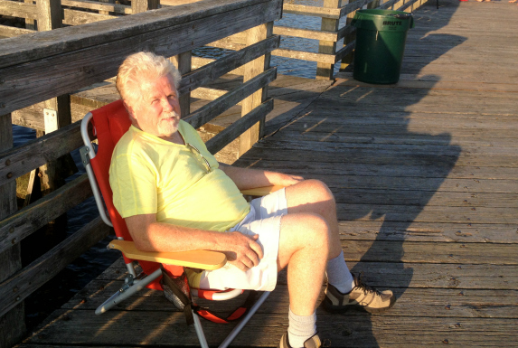 Kyle's grandpa Dennis relaxing as Kyle baits all the hooks by himself.