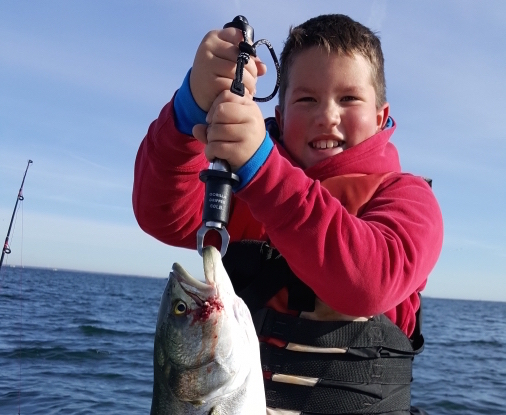 eric meyer's son with a bluefish