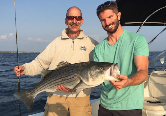 Rick Handman and Ryan Collins with striped bass
